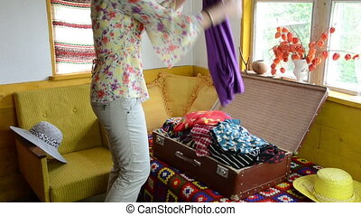 woman suitcase full cloth - Woman girl fill old suitcase...