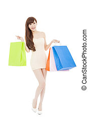full length of  lovely asian woman with shopping bags