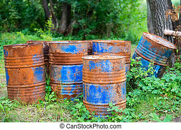 old rusty painted barrels outdoors
