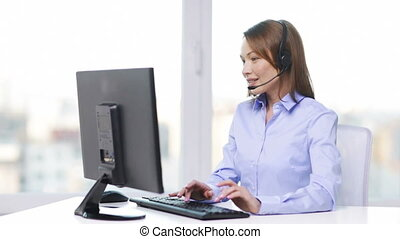 female helpline operator with computer at office - business...