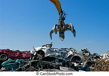 crane cars - Crane picking up crushed cars