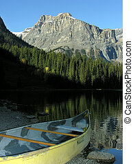 Canoe on a shore of Emerald Lake, Yoho National Park, Canada...