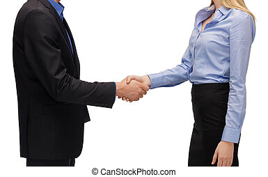 man and woman shaking their hands - business people and...