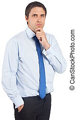 Thinking businessman touching his chin
