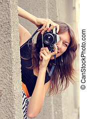 woman with old camera outdoors