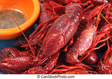 steamed crawfish on dish served with lime juice, salt and...