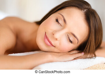 beautiful woman in spa salon - beauty and spa concept -...