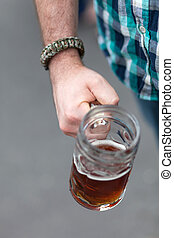 Octoberfest Beer Stein - Close up of a mans hand holding a...
