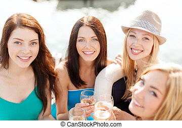 smiling girls with champagne glasses - summer holidays,...