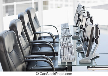 Chairs, computers and headset in a modern office - Side view...