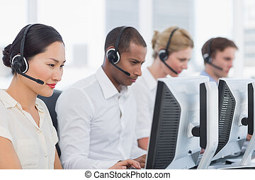 Colleagues with headsets using comp