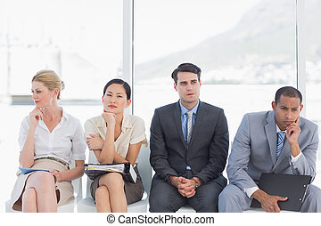 Business people waiting for job interview in office - Four...