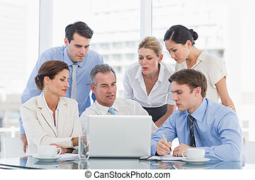 Business colleagues with laptop at - Group of business...