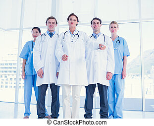 Doctors standing together at hospital - Group portrait of...
