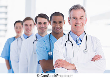 Doctors standing in a row at hospital - Group portrait of...