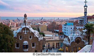 parc guell skyline sunset to night - barcelona skyline view...