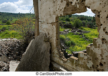 remnants of war - bullet traces and rubbles of war against...
