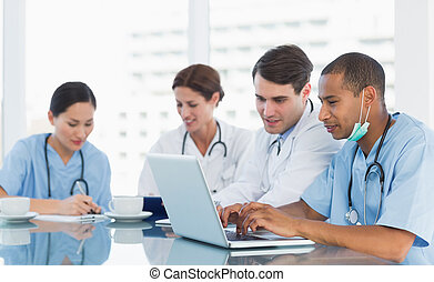 Doctors in a meeting at hospital - Group of young doctors in...