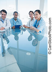 Doctors in a meeting at hospital - Group portrait of young...