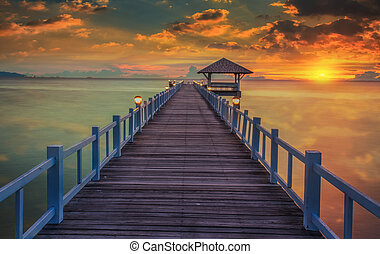 Wooded bridge in the port between sunrise at pattaya beach...