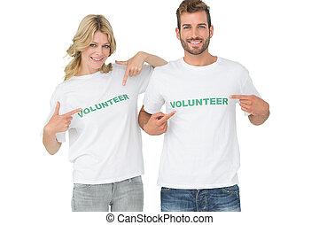 retrato, dos, feliz, voluntarios, Señalar, ellos...