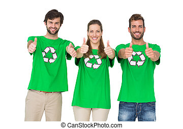 People in recycling symbol t-shirts gesturing thumbs up -...