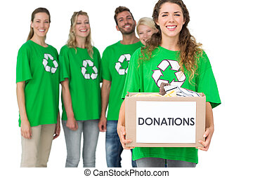 People in recycling symbol t-shirts with donation box -...