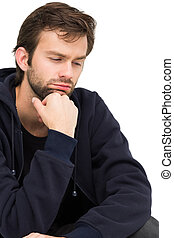 Close-up of a stressed handsome young man over white...