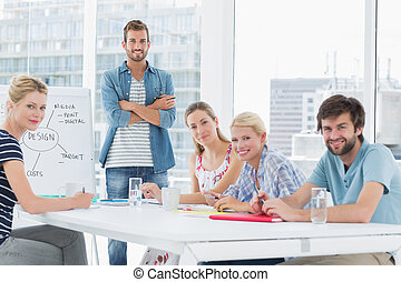 Casual business people around conference table - Young...