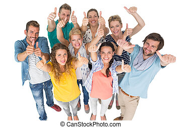 Portrait of casual cheerful people gesturing thumbs up -...