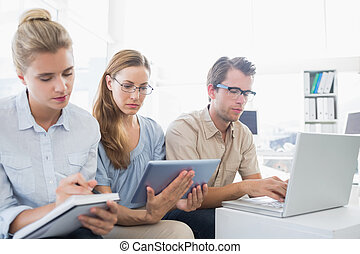 Concentrated three young people in office