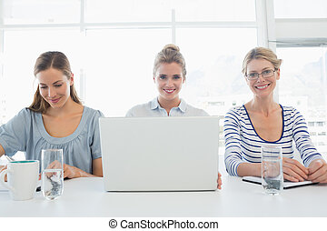 Three young people working in office