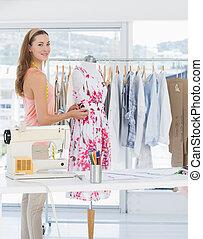 Beautiful female fashion designer w