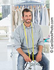 Portrait of a male fashion designer in studio