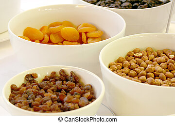 bowls of nuts and rasins