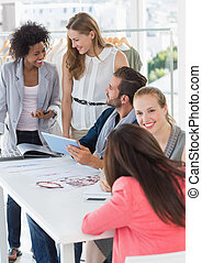 Fashion designers discussing design - Group of fashion...