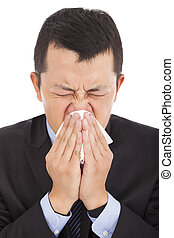 young businessman is sneezing with painful face