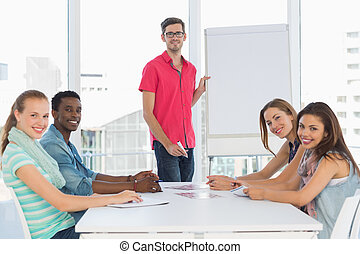 Casual business people in office at presentation - Portrait...