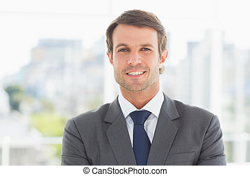 Businessman standing over blurred background outdoors