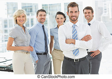 Confident business team together in