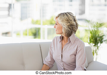 Thoughtful mature woman at home - Thoughtful mature woman...