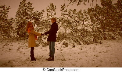 On a date. Old movie - Couple on a date in a winter forest