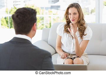 Smiling woman in meeting with a financial adviser - Smiling...