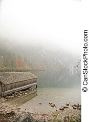 boathouse at lake in fog