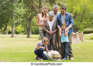 Extended family with their pet dog