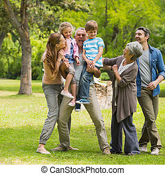 Extended family playing in park - Full length of an extended...