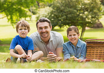 Smiling father with young kids - Portrait of a smiling...