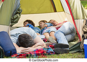 Family sleeping in the tent at park - Couple with kids...
