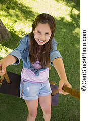 Cute little young girl on swing - High angle view of a cute...