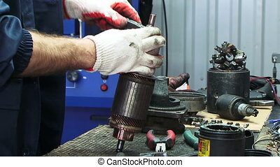 Electrical starter - Mechanic working with electrical...